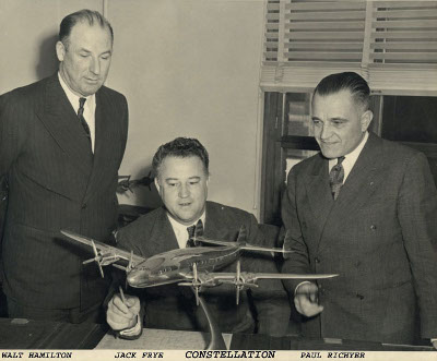 Walter Hamilton, Jack Frye and Paul Richter look at the new Lockheed Constellation... The Trans-Atlantic airliner that revolutionized the aviation world.