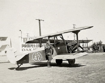 Paul Richter preparing the Curtiss aircraft for flight.