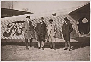 William Mayo, Bill Stout, Edsel and Henry Ford in front of Trimotor