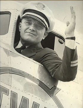 Paul Richter waving out of the cockpit window